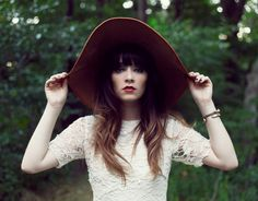 dark felt hat and lace top