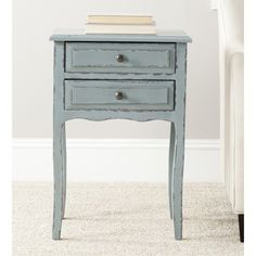 @Overstock.com - Lori Distressed Pale Blue Accent Table - Feminine without the frill, the petite and traditional Lori end table was inspired by a hidden treasure at a Paris flea market.  http://www.overstock.com/Home-Garden/Lori-Distressed-Pale-Blue-Accent-Table/8429353/product.html?CID=214117 $150.99