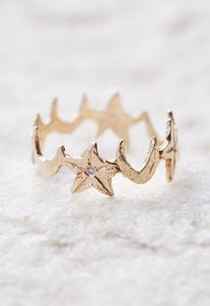 Celestial inspired star and moon eternity band is made from 14k gold and features stunning white diamonds in the center of the stars to add a little bit of twilight sparkle. Boho ring from Free People