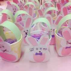 Easter baskets - Foam cup painted in pastel colours with a handle and a bunny attached  Children glued the bunny together with pre-cut shapes independently using an example then glued on joggle eyes and drew a nose and whiskers