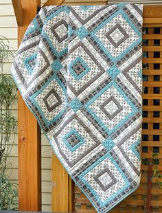 Melbourne Shuffle is a fun variation on classic log cabin quilts, or the Courthouse Steps quilt block. This twin-size quilt is traditional, yet updated, alternating dark and light, like traditional log cabin quilt layouts. Read more on the Fons & Porter website!