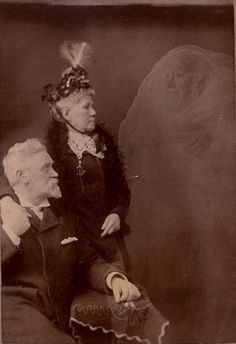 Robert Boursnell (England)    Couple with the Spirit of an Old Family Doctor who Died Around 1880    Collodion print, 4 x 5.75 inches    January 3, 1893