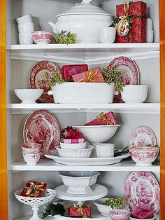 Red, White & Green  -- Jazz up your plain white dishes for Christmas by adding red-and-white transferware to the display. (A few pieces make a big impact.) Complete the display with tiny wrapped gifts and sprigs of holly or ivy.        Editor's Tip: Wrap small boxes with leftover wrapping paper that would otherwise go to waste.