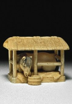 Horse in stable. Japanese netsuke, made of ivory, by Kaigyokudo