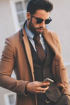 Topcoat, camel coat, brown vest, brown tie, and sunglasses. Sharp Dressed Man, Well Dressed Men, Mens Fashion Suits, Mens Suits, Fashion Vest, What To Wear Fall, How To Wear, Mode Man, Man Style