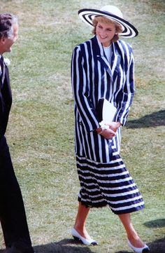 July 11, 1989: Princess Diana, the Princess of Wales, strolling and talking with people who attended the Garden Party in the grounds of Buckingham Palace, London. (AP Photo/Allen)