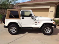 1998 Jeep Wrangler Sahara. Excellent shape. 4.0L engine, auto trans, 3 lift, custom wheels & tires, cool AC, AM/FM/CD player, only 66,400 original miles, never been off road, white with tan interior, *SIGH*