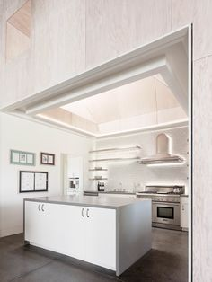All white kitchen nook features a subway tile back-splash and skylight in this home in St. Helena California. [2160  2880]