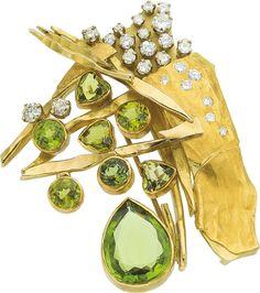 Peridot and Diamond Brooch. Featuring a pear-shaped peridot weighing aprox 6.00c, enhanced by heart, pear and round-cut peridots weighing aprox 4.50c, accented by full-cut diamonds weighing aprox 1.35c, set in 18k gold, with gold marked Joniye. | via jewelery.ha.com