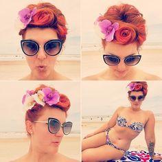 work a vintage updo with lots of flowers and victory rolls! 🌸☀️🌊😘 • • • • • • • • • #goodhairday #vintagehair #vintagehairstyle #orange #hairstyle #instahair #haircolour #hairdo #redhead #pinupgirl #retrohair #retrohairstyle #suicideroll #wetset #victoryrolls #bikinibody #hairoftheday #perfectcurls #tikihairflower #hairfashion #vintagestyle #redhair #vintage #pinup #pinuphairstyle #retro #rockabilly #hairflowers #beachli...