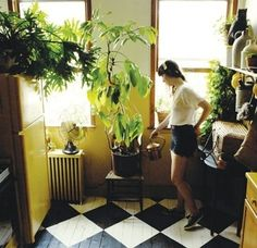 Love these floors. Reminds me of my grandmother's house. She had the black and white checkerboard floor. I love the plants in here too <3