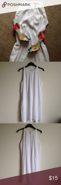 BCBG Max Azria dress Beautiful and cute white pleated cocktail dress from BCBGMaxazria. Good condition with a small makeup stain on collar. Perfect for the bride at a rehearsal dinner! BCBGMaxAzria Dresses
