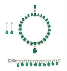 SUPERB JEWELS FROM THE COLLECTION OF H.S.H GABRIELA PRINCESS ZU LEININGEN: A SUITE OF EMERALD, DIAMOND AND PEARL JEWELLERY, BY CARTIER. The necklace designed as a fringe of graduated emerald bead drops, interspersed with diamond briolette drops and pearls, suspending a larger emerald bead pendant with briolette-cut diamond and oval cabochon emerald surmount, to the similarly-set pendant clasp, a bracelet and a pair of ear pendants en suite.