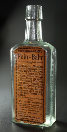 Chamberlain's Pain-Balm - Aqua, molded tapered lip, rectangular, 6 1/2in (167mm) tall. Embossing: CHAMBERLAIN'S PAIN-BALM (on back), CHAMBERLAIN MED. CO (on side), DES MOINES, IOWA (on other), Label (on front) - c1890