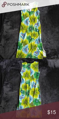 "California Grown Maxi Dress With Slit Super soft and light weight maxi dress with  green and blue flower print design on front and back and 14"" slit on the left side. Great condition.  92% Polyester 8% Spandex  Neckline to Hemline: 35"" Slit: 14"" up from hemline California Grown Dresses Maxi"
