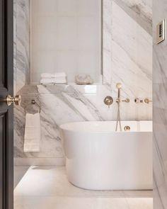 marble + sleek white bathtub | interior style