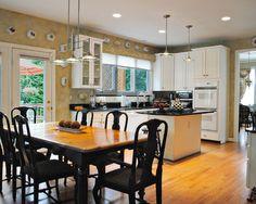 Eat-In Kitchen: Light Tan, Black and White by Bart Goldstein Interior Design.    www.bartgoldstein.com