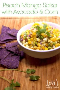 Peach Mango Salsa with Avocado and Corn perfect for summer entertaining. Light, fresh and great with chips or on seafood.