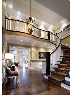 Stair Systems | curved staircase with designed carpet | Bayer Built Woodworks
