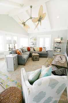 I love this gyro style ceiling fan! It's a perfect accent to this gorgeous room.