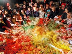 Yu Sheng, or Yee Sang, is a traditional food ritual during the Lunar New Year. Diners toss ingredients high in the air to wish for luck and happiness. (Photo/Xinhua)