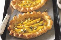 Mango tarts A great dessert using fresh mangoes baked on pastry cases. This is easy to make with ready made pastry. Chopped pistachios are sprinkled on top for added crunch. Easy Pudding Recipes, Tart Recipes, Great Recipes, Cooking Recipes, Great Desserts, Dessert Recipes, Mango Tart, Savory Tart, Mini Pies