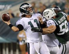 Eagles' quarterback Trent Edwards gets ready to throw a touchdown pass against the New York Jets' Garrett McIntyre during the second quarter in a preseason game on Thursday, August ( Yong Kim / Staff Photographer ) Lincoln Financial Field, Philadelphia Eagles Football, New York Jets, Football Helmets, Nfl, Two By Two, Thursday, Sports, Game