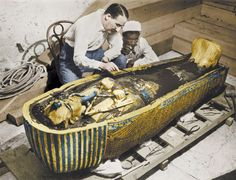 Howard Carter, in the tomb of Tutankhamen in 1922 The thick black substance covering the body is mumma, the origin of the word mummy.