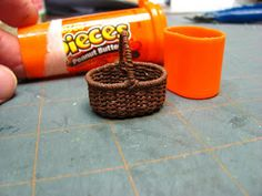 Dollhouse Miniature Furniture - Tutorials | 1 inch minis: Weaving a Basket with Crochet Thread Tutorial - How to weave a basket using painted crochet thread and covered wire.