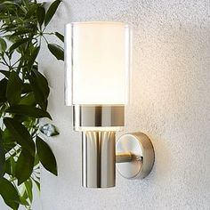 Add a modern touch to your home with this neutral design, perfect for an array of home decors. Constructed from a stylish stainless steel material, this product is durable and well equipped for all weather types. Outdoor Wall Lighting, Outdoor Walls, Lighting Ideas, Light Beam, Glass Diffuser, Stainless Steel Material, Fashion Lighting, Clear Glass, Wall Lights