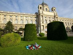"""Vienna ~ Art History Museum    Photograph by Catherine Karnow    Two young women linger on the lawn near the Art History Museum (Kunsthistorisches Museum), home to collections assembled by Austria's royal Habsburg family.    Read more in """"Courting Vienna"""" from the November/December 2011 issue of National Geographic Traveler."""