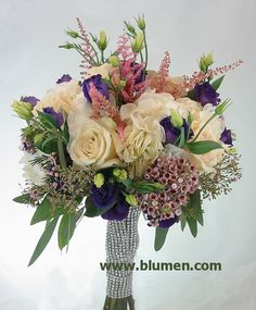 Bridal bouquet of white hydrangea, dark purple lisianthus, Sahara roses, blush astilbe, pale pink waxflowers and seeded eucalpytus, wrapped in diamond mesh; Blumengarten Florist, www.blumen.com