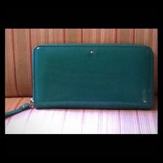 NWOT Kate Spade Harrison St. Lacey Wallet NWOT Kate Spade Harrison St Zip around Wallet - Beautiful Green color with gold hardware.  12 card slots, 2 bill compartments, and a zippered coin compartment.  Brand new without tags. kate spade Bags Wallets