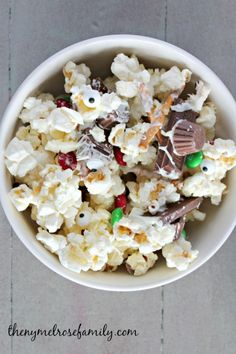 This Melted Snowman Popcorn recipe is the perfect mixture of sweet and salty! Treat your friends to this snack at your next movie night in!