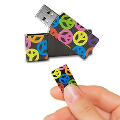 EMTEC Swivel Series 4GB USB 2.0 Flash Drive (Peace Signs) Stop using boring flash drives, and give your flash drive a little personality with the EMTEC Swivel Series 4GB USB 2.0 Flash Drive. This small, compact flash drive features a bright peace sign design and includes 4 GB of storage capacity. Now, you can store and transport all your most important photos, videos, music, and files. The flash drive features a swivel design so the USB connector easily swings in and out of the casing, which…