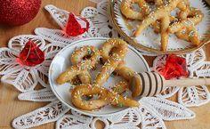 Scauratiellicilentani In Natale in Cilento non è Natale senza queste deliziose zeppoline fritte e ricoperte di miele e zuccherini colorati. Le tradizioni