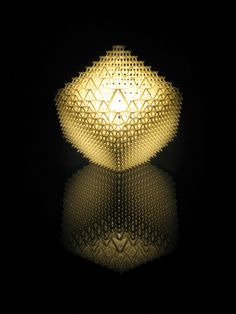 Shine a LightBenshetrit's table lamp, for the lighting and furniture company .MGX by Materialise uses QuaDror's infinitely scalable geometry to create a honeycomb of 1,200 modules that fits over a metal base holding a 40-watt halogen bulb. The lamp, which arrives flat and expands, accordion-like, when lifted, is manufactured via selective laser sintering (SLS), a 3-D printing process that uses a laser to solidify layer upon layer of powdered resin particles.