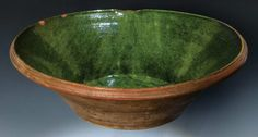 Willis Henry Auctions.  March 29, 2014.  Lot 29B: Rare Milk Pan.   Estimate: $800 – $1,200. Sold: $856.   Late 18th/early 19th c., Bristol County, green copper glaze on white tin slip underglaze, a few rim chips, shaped pouring spout, flared sides, 5″ h, 18″ dia.