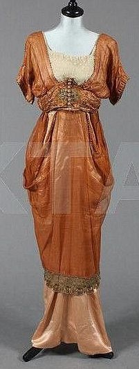 """Circa 1910 Madame Ernest Ltd cinnamon gauze silk and satin dress with elaborately embroidered waistband, metal thread wrapped buttons, beads and rosettes.  The internal tulle camisole with elasticated silk straps, the pink satin hobble skirt with deep boned inner waistband.  Get the first chapter of """"The Secret Life of Anna Blanc"""" free at http://bit.ly/1m4RWWo"""