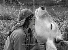 Norman Reedus kissing a cow.