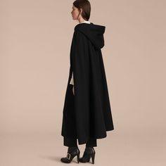 A hooded cape, made in Italy from mid-weight wool woven with a hint of cashmere for noticeable softness. Satin-lined, it is cut long with clean lines for an elegant silhouette.