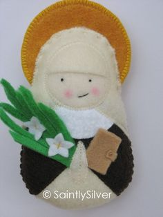 I have a basket full of these little saints.  Love them!