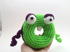 """Vote for Lola-Ray by TheKnitKnackShop - http://www.amigurumipatterns.net/designcontest/vote/?id=913 - This little one is often confused as it has two sides and two personalities. It's green half, Lola, loves rummaging in the grass for vegetables to eat. It's purple half, Ray, would rather be doing something nefarious. They don't often see eye to eye except when it comes to """"borrowing"""" candy from unsuspecting trick-or-treaters."""