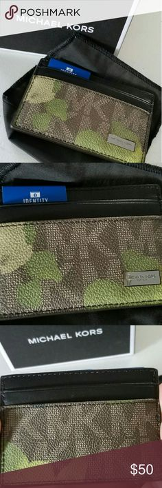 Michael Kors jet set card case $ 58 NWT Michael Kors jet set evergreen card case NWT $58 2 card slots on front, 2 on back, center pocket. Comes with satin pouch, box, price tag. My husband didn't like it Michael Kors Bags Wallets