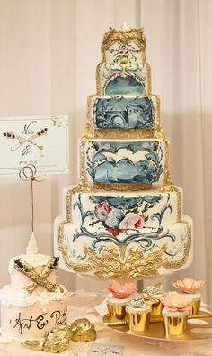 This cake is just incredible! White and gold Baroque wedding cake with blue hand-painted garden scene.