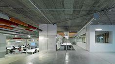 Díaz y Díaz Arquitectos. Coworking Area. Open office space. Interior design. Concrete floor. Color ceiling. Architecture