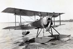 August 2, 1915: Building upon 1913 flying-off experiments aboard HMS Hermes, an aircraft takes off from a platform aboard a fully operational British aviation ship for the first time, when a Sopwith Baby equipped with wheeled floats takes off from HMS Campania.