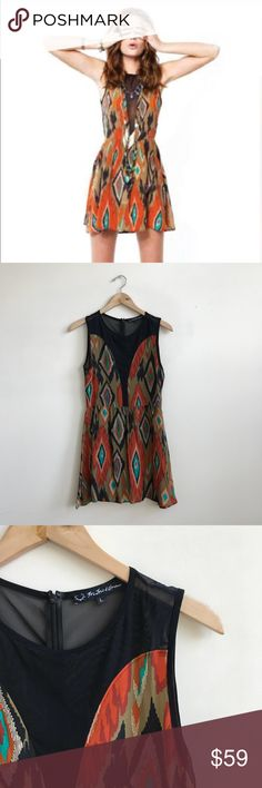 For Love and Lemons Aztec Print Silk & Mesh Dress Aztec Print Silk and Mesh Dress from For Love and Lemons. Size Large. Excellent pre-owned condition with no flaws or signs of previous wear. Silk with mesh details and back. Perfect breezy little dress! No trades. For Love And Lemons Dresses Mini