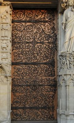 one of the front doors to notre dame cathedral