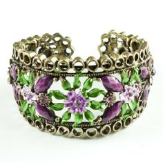 """Purple Marquise Resin Rhinestone and Painted Flower Goldtone Bangle Bracelet Leisureland. $19.99. Extendable to fit various wrist sizes. Made with resin rhinestones. Easy on and off. Diameter: 2.5"""". Lead compliant. Save 43% Off!"""